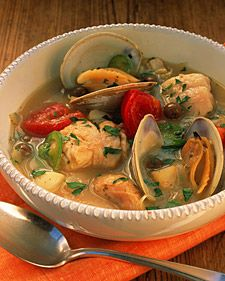 A Basque seafood stew features bay scallops, red snapper, and clams in their shells; tomato wedges, tiny Spanish olives, and a garnish of chopped fresh parsley round out the flavors. Although we used steamer clams, smaller varieties such as cockles or littleneck can be used for a more refined stew. Spanish empeltre olives are slightly sweet and very succulent. Picholine olives work just as well.