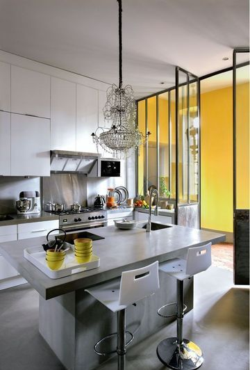 Love the yellow wall and the chandelier...