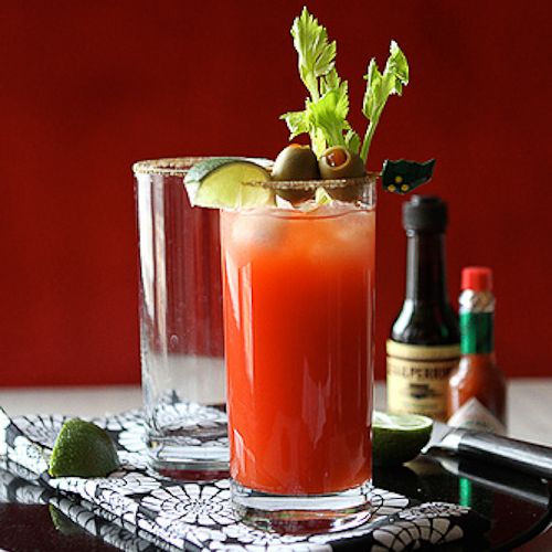 "The Caesar Cocktail, aka the Canadian Bloody Mary...with the addition of stuffed olives....""little drunken orbs of joy""!"
