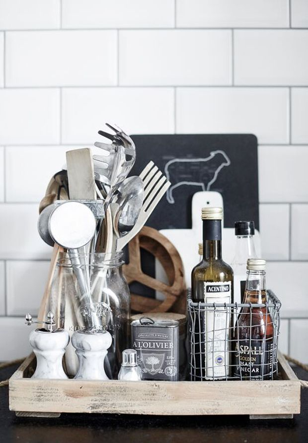 A monochrome look (Olivia Blog and Concept Store) - When you corral items on your counter tops that you use everyday, you keep things neat AND can make a decorating statement.