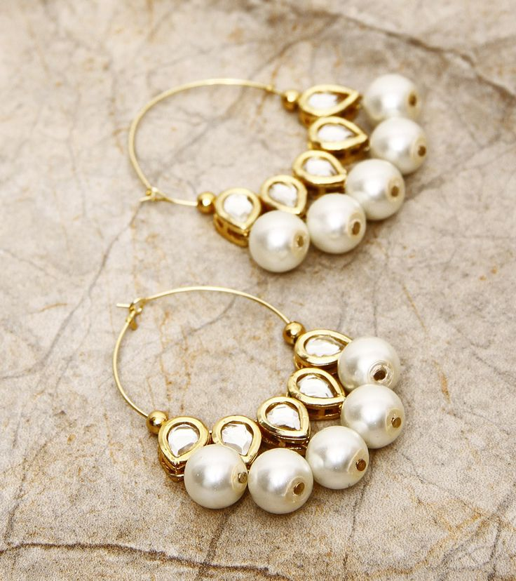 Pearls are timeless and can instantly add a touch of elegance to your look.