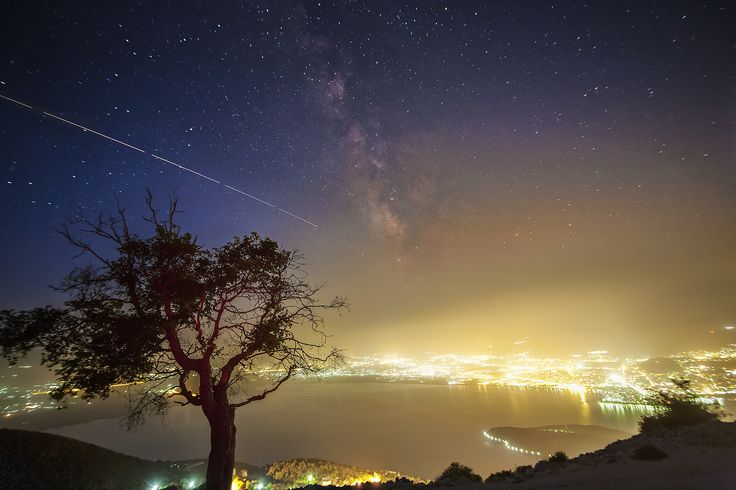 MilkyWay vs. City by Constantine Emmanouilidi on 500px