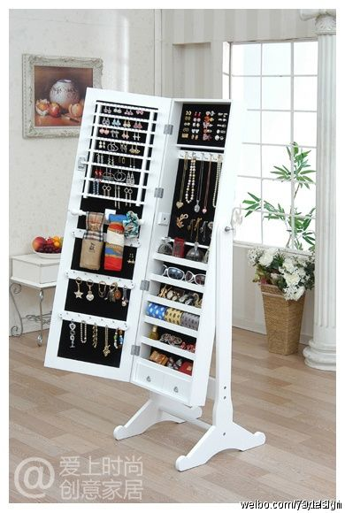 DIY project? like a medicine cabinet, only ALL jewelry storage (oh, to have it all in ONE place!)...and wall mounted to access contents more comfortably and at a height I can see myself easily without having to adjust it.