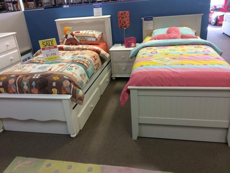The bed on the left has drawers underneath the bed.
