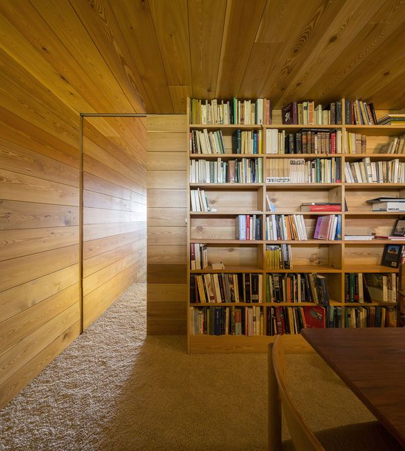 The library is accessed by a sliding wood door.
