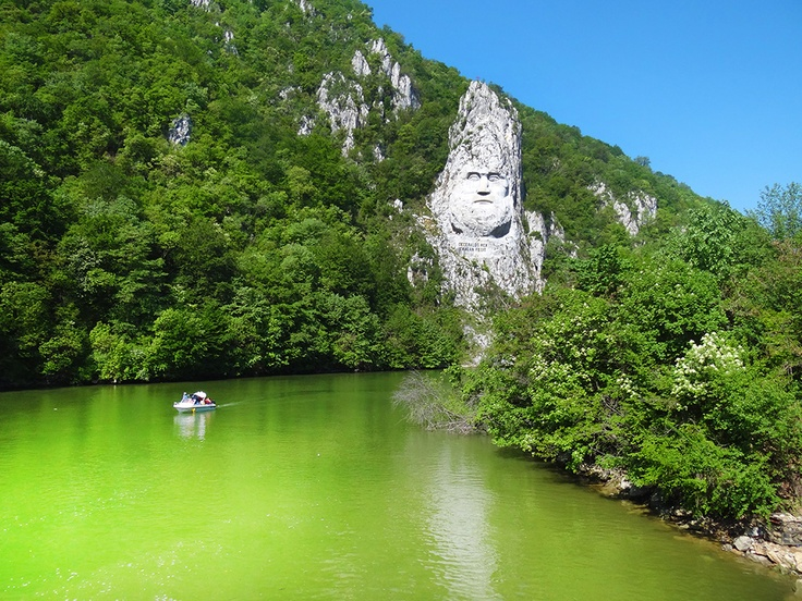 We cannot get enough of this statue, and what makes it even more awesome is it's humongous size! Look at how small the boat looks, and it's an 8 person boat.  Decebalus Rex (King Decebal), Dubova, Romania.