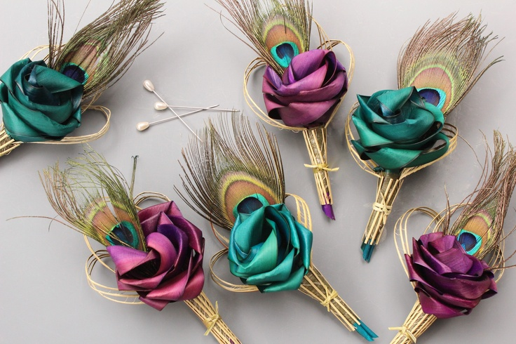 Peacock buttonholes in turquoise & pink/purple by Flaxation