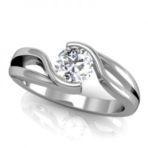 This truly unique twist-style solitaire setting features a split-shank design, and a semi-bezel shape around the centre diamond. This setting is shown with a .65ct. round brilliant centre diamond (sold separately), and can hold a round centre diamond of approximate .45ct to 1.10ct of your choice.