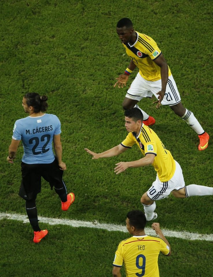 This World Cup Wonder Goal Needs To Be Seen Again And Again - Colombia's midfielder James Rodriguez (R) runs past Uruguay's defender Martin Caceres (C) with teammates Colombia's forward Jackson Martinez (TOP) and Colombia's forward Teofilo Gutierrez (FRONT) as he celebrates his second goal