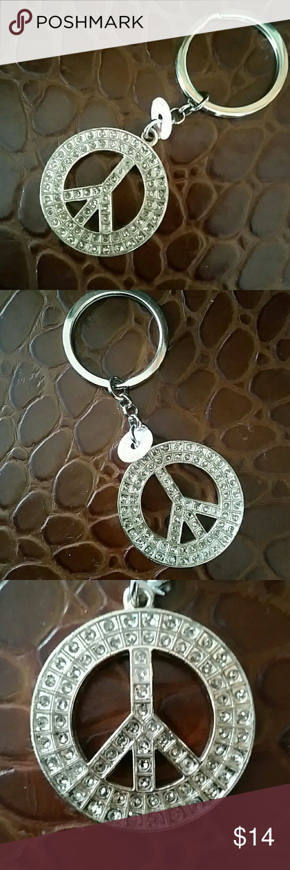 "NWT PEACE SYMBOL GLAM Rhinestone key chain NWT PEACE SYMBOL GLAM Rhinestone key chain  Make a statement of PEACE with this glam girl stylish key chain Jewelry for your purse, keys and car! Symbol measures 1.5"" across and is jeweled on both sides Keyring measures about 1-3/8"" across Heavy duty Available in pink,clear,green, blue and purple colored rhinestone like jewels. See other listing for available colors flattered Accessories Key & Card Holders"