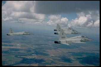 Four Northrop T-38 Talons fly in formation. In 50 years, the T-38 has been used to train more than 70,000 pilots.