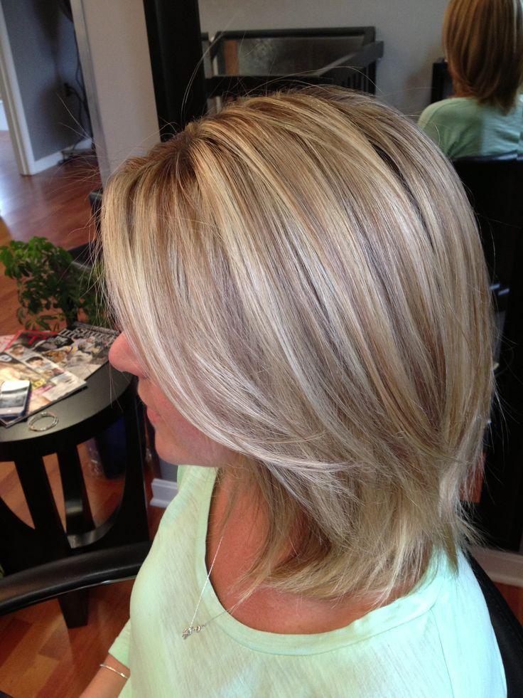 Ash blonde highlights on short side swept hair