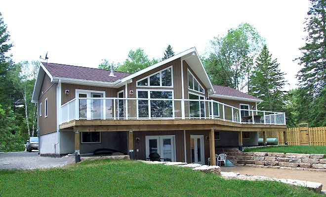 Moore Lake 9, located near Minden in the Haliburton Highlands, Ontario. Fairly flat property with child safe sandy bottom beach, furnished for your vacation comfort. Sleeps a maximum of 10
