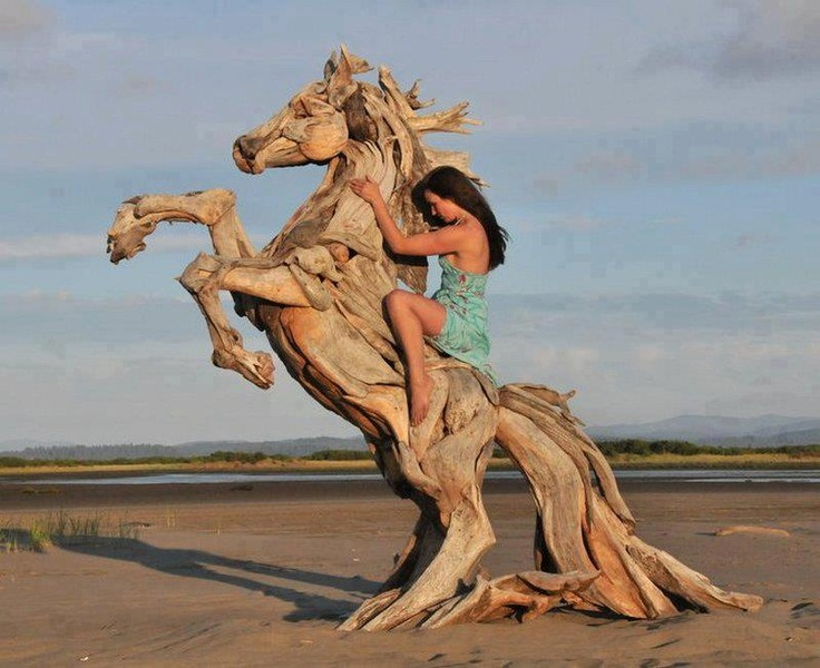 Beautiful sculpture. Is it from a trunk? Like a real tree in this sand? Double the awesomeness in this case.