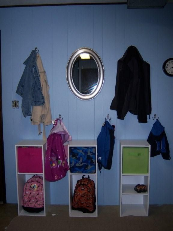 lots of different ideas.  Like this one - can put backpacks in the bottom and papers in the bins.
