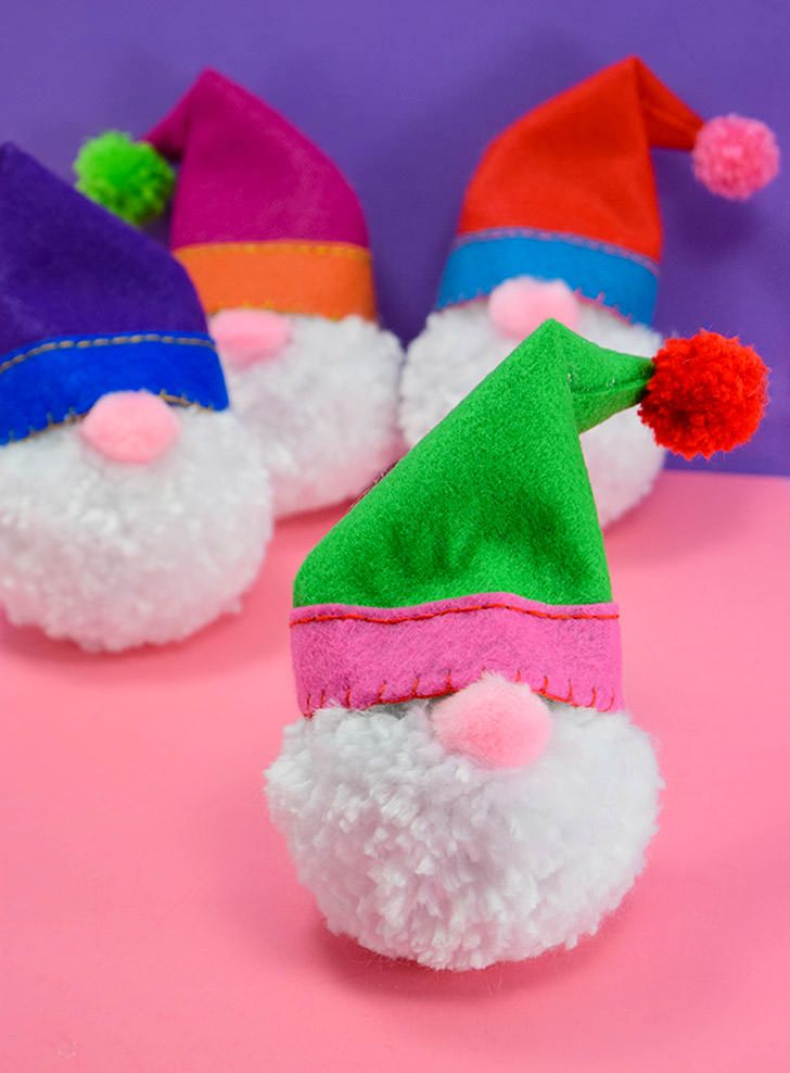 Some yarn and felt will make the cutest pompom gnomes you've ever seen. They are great as fun decor items or perfect on your tree as Christmas ornaments!
