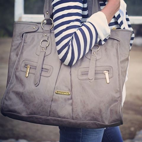 Well, doesn't look like a diaper bag, but it actually is. One of timi & leslie's fashionable diaper bags in grey.