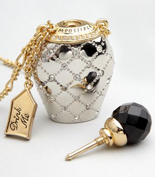 Necklace with Swarovski crystal-studded ,platinum-plated perfume bottle with a faceted stopper that you can twist off