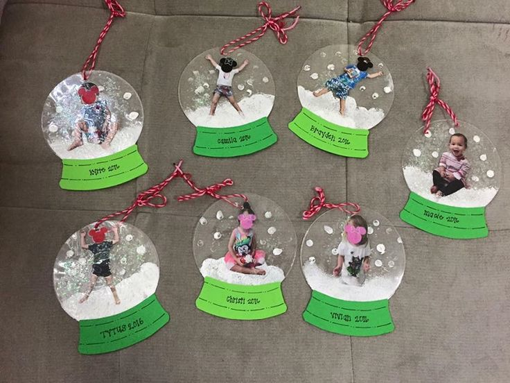 """These darling little photo snowglobe ornaments were made by Megan Hayashi! Here's her tutorial…""""Painted inside of one side of laminating sleeve. Placed picture on top and added some glitter. Then laminated with clean side of sleeve on top. The base is made out of cardstock paper."""" What a cute Christmas gift for parents and family! …"""