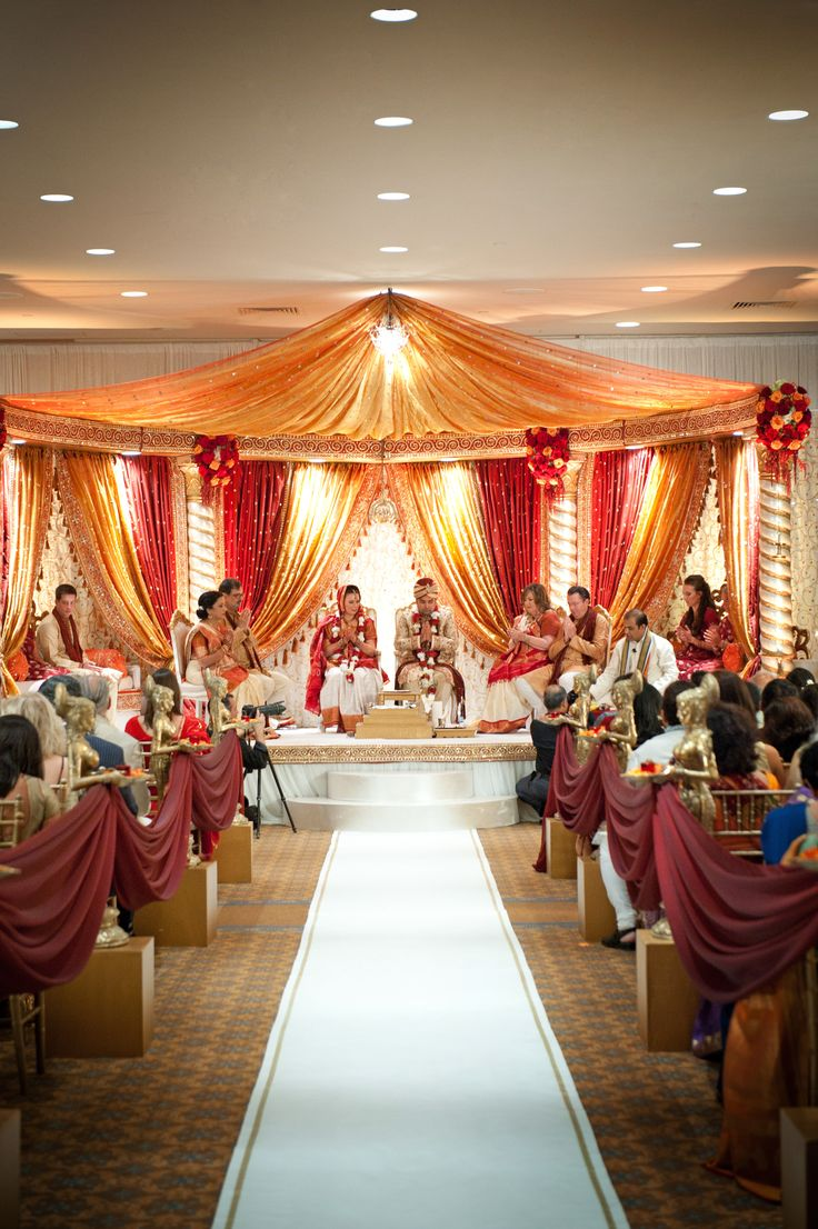 red and gold open style mandap