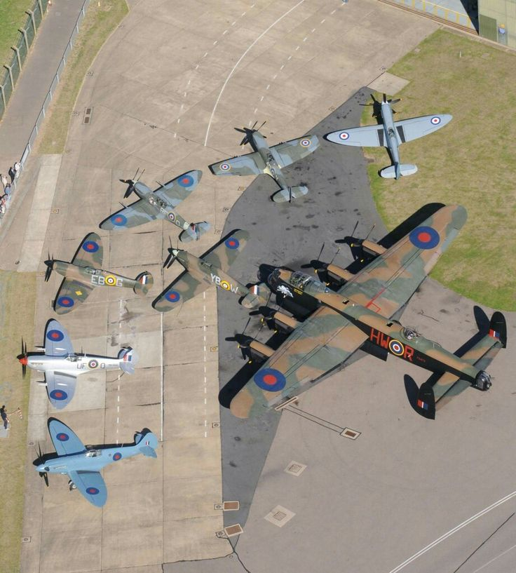 Avero Lancaster circled by Supermarine Spitfires & One Hawker Hurricane ~ BFD