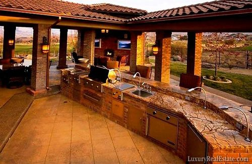 Awesome outdoor kitchen/living space -- 10 Most Amazing Outdoor Home Theaters | Geek About