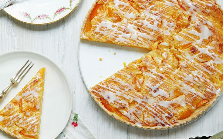 A smart, delicate tart starring tender apricots and an almond frangipane   filling in a crisp pastry case. Apricot-scented icing adds a pretty   finishing touch