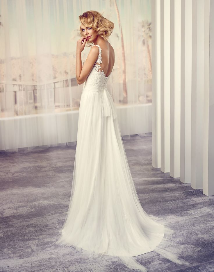 STACEY // This wedding dress is an instant hit with its tight fitting lace bodice and straps that flow into airy chiffon/tulle and are complemented by a low-cut open back