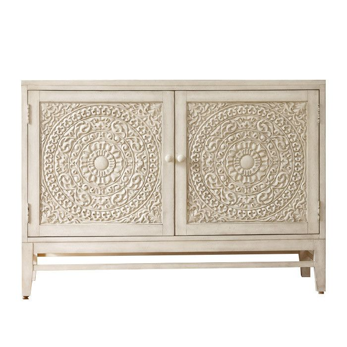 Perfect for stowing table linens in the dining room or everyday essentials in your entryway, this 2-door cabinet offers elegant style with carved medallion-inspired fronts.