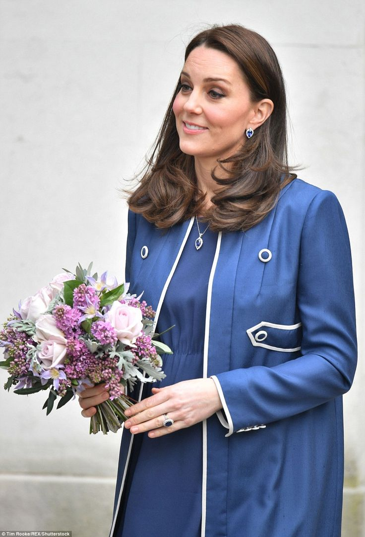 Old favourite: Kate turned to one of her preferred designers, Jenny Packham. What Kate is wearing today Feb 27 2018.  Jenny Packham, blue empire waist maternity dress with matching blue cardigan style coat with white piping.