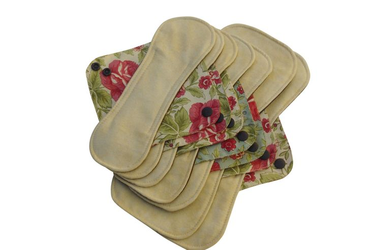 Deluxe Set of 7 Period Pads $58.00 Available in Cranberry, Espresso, Sage Green or Cream with coordinating wing fabric Machine washable and dryable! Set includes three panty liners, two day pads, and two night pads. Environmentally friendly alternative to disposable products. Comfortable and durable.