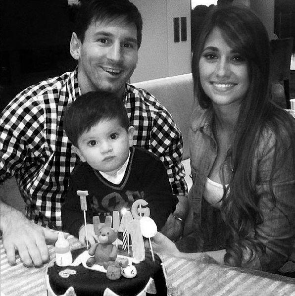 Lionel Messi and Antonella Roccuzzo with their son Thiago.