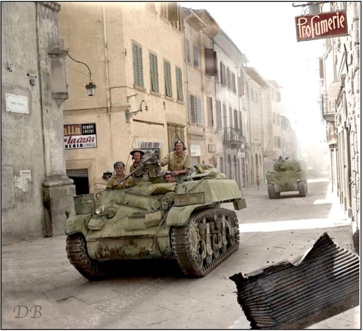 A Stuart reconnaissance tank and a Sherman of the 27th Armoured Brigade, 6th Armoured Division in Corso Italia, Arezzo, Tuscany in Italy 16 July 1944.  The Germans made a stand in front of Arezzo early in July 1944 and there was fierce fighting before the town was taken on 16 July by the 6th Armoured Division with the aid of the 2nd New Zealand Division.