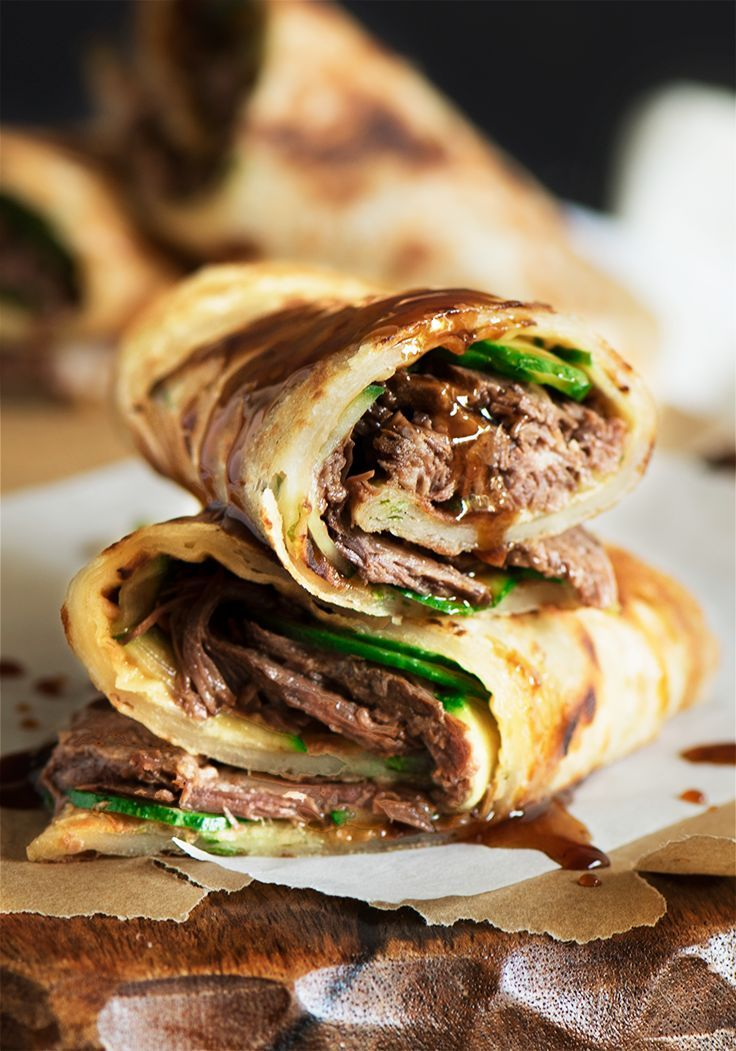 Crispy flaky chewy scallion pancake, fresh crunchy cucumber & a warm melt in the mouth tender beef with a sweet & savory sauce all throughout.: