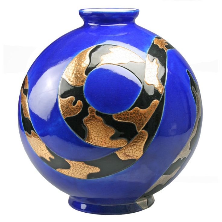 This is a large and striking boule vase with two intertwined snakes. Designed in the Art Deco style by Danillo Curetti, it is number 3 in the edition. These were produced in limited editions. Curetti worked for Longwy in the 1980's. He died in 1993. The vase has its original price tag from the Chicago department store Marshall Fields .