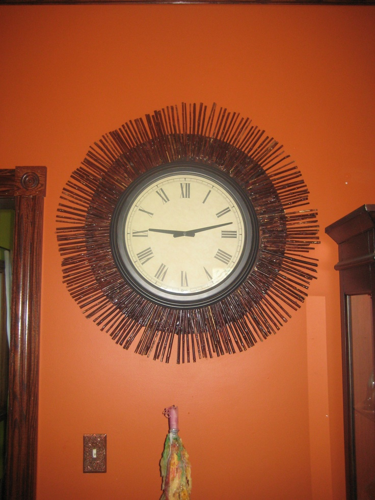 I have my own bamboo growing and every year I cut it back to cure for crafting.My living room is huge and my clock looked like it was drowning on the wall.So...I cut a plywood circle,glue bamboo on and stained it to match my wood trim.Then I put a hole in the plywood for my nail to hook on the wall with my clock.Voila!I think I have a one of a kind here and I love it.