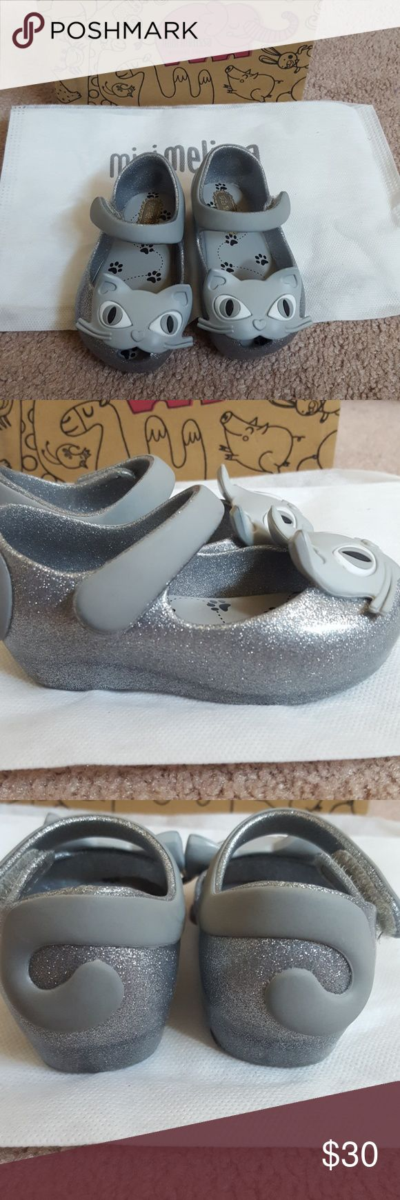 Authentic Mini Melissa Ultragirl II Cat shoes Authentic silver glitter Mini Melissa shoes. In great condition! Box and dust bag are included. These are toddler size 5, but run more like a 4.5. Mini Melissa Shoes
