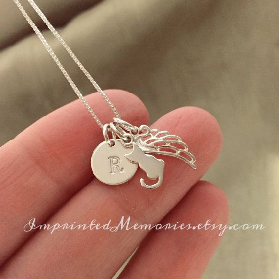 The perfect personalized gift to remember a special kitty in your life. Sweet, simple and timeless. Personally handmade by me using only the highest quality sterling silver to last a lifetime. Memory My angel has Whiskers  This gorgeous necklace includes: ~ One tiny (please see all pictures for scale) 1/3 diameter, thick, 0.925 solid silver disk ~ Disk is personally hand stamped to order by me ~ Very tiny Solid Sterling silver cat charm ~ Solid sterling silver angel wing charm ~ Strong 0.925…