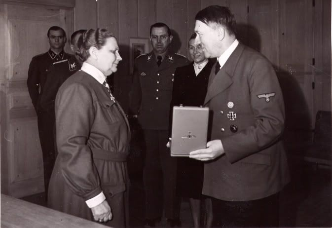 Finnish leader of the Lotta Svärd organization Fanni Luukkonen receives the Order of the German Eagle with Star from Adolf Hitler on May 19, 1943. Under Luukkonen's leadership, Lotta Svärd, a voluntary auxiliary organisation for women, grew to 232 000 members, the largest women's organisation in Finland, and even in the world.
