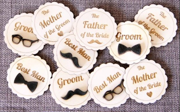 Wedding badges  ID badges for team groom and team bride is a trending style to help your guests identify your people in case they need any help. You can make your loved ones look fancy with customized badges and funky emblems in your convivial moments.