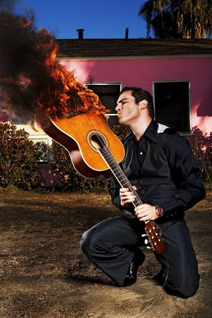 Joaquin Phoenix as Johnny Cash : Michael Muller Photography.  Such 'tude-Johnny would never do that to one of his guitars-still, love the pic!