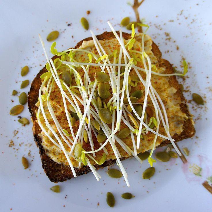 Hummus toast with pea shoot and pumpkin seeds