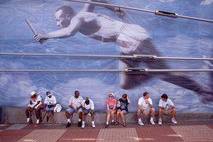 Jesse Owen: People sit under mural of Jesse Owens