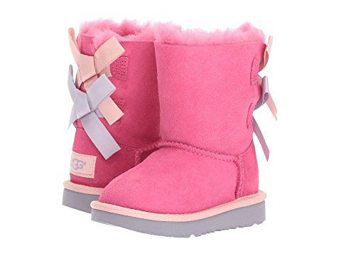LOVE these UGG Kids Bailey Bow II girls boots in Pink Azalea/Icelandic Blue for toddlers and little kids. These boots feature a Twinface and suede upper with a round toe.  The sheepskin is treated on both sides to provide maximum softness and comfort.