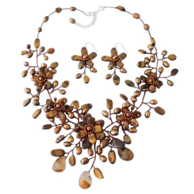 Add some feminine finish to your look with this necklace and earrings set that showcases dyed brown pearls and tiger's eye gemstones defining a chic floral bouquet style. This jewelry set was handmade in Thailand.