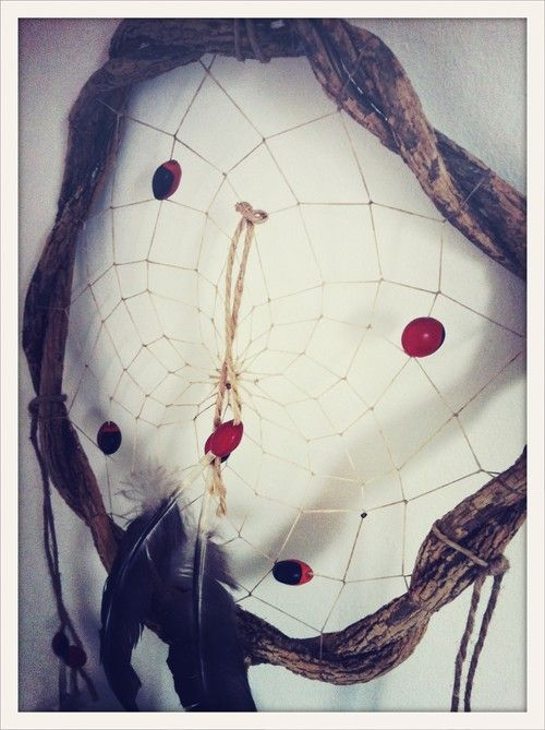 The Catcher in the Rye - Salt & Pepper Feather.  Hand made South American dream catcher. Keeps the bad dreams at the door.