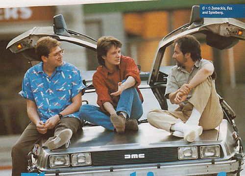 Robert Zemeckis, Michael J. Fox, Steven Spielberg and the DeLorean on the set of Back To The Future.