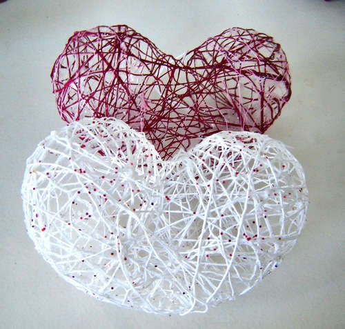 How to make String Hearts. Inflate 2-small oval balloons. Tie them together at the tie/bottom of balloon. Cover with string dipped in liquid starch. When string is dry, pop the balloons.