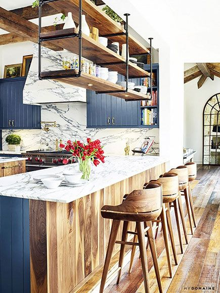 "Go Inside Brooklyn Decker's Comfortable Austin Home (She Designed it Herself!) | BABY BLUES  | The greyish-blue color on the kitchen cabinets was a product of trial-and-error. ""I originally wanted to go all green – a very high gloss, creamy vibrant green,"" Decker said. ""We couldn't find a color that worked. Then we tried several grays and ventured into the blue territory. When the marble came in, we realized how much it drew the blue and gray out of the stone. I don't know if it's a perfect…"