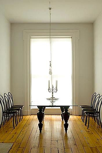 Fernlund + Logan, a New York City firm that counts designer Ted Muehling among its clients, creates a thoroughly mod interior within a traditional Manhattan townhouse, mixing classics (a Le Corbusier LC4 chaise) with future classics (Jasper Morrison Glo-Ball lights and a Marcel Wanders New Antiques table). Candelabras and a crucifix over the mantle add an edgy note. Photos by Verne.